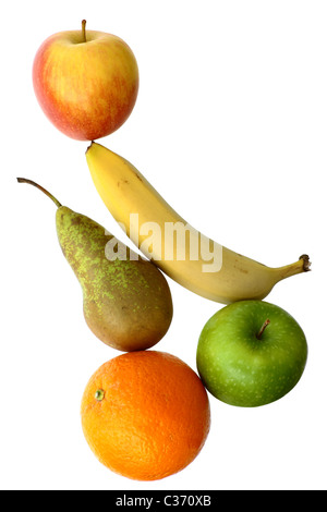 Mixed fruit in a still life arrangement isolated on a white background with copy space. - Stock Photo