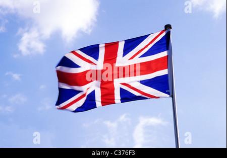 Union Jack Flag British national flags flagpole pole poles UK flying in wind flagstaff England UK English Red white - Stock Photo