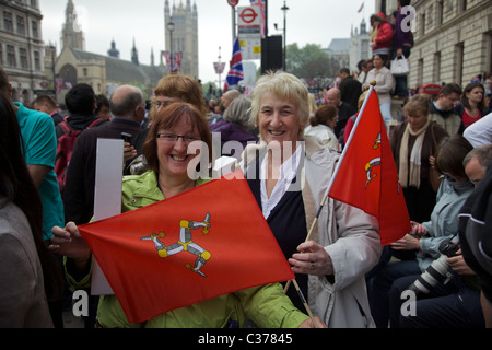 Two ladies from the Isle of Man showing there Island's flag at the Royal wedding in London - Stock Photo