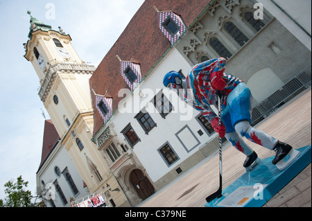 Statue of Slovak hockey player near old town hall in Bratislava center during ice hockey championships in Bratislava, - Stock Photo