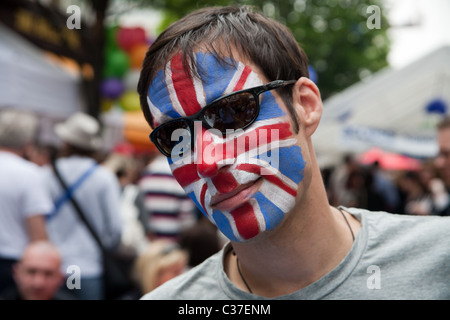 Man wearing a mask - Wedding of Prince William and Kate Middleton - Street Party on Battersea High Street London - Stock Photo