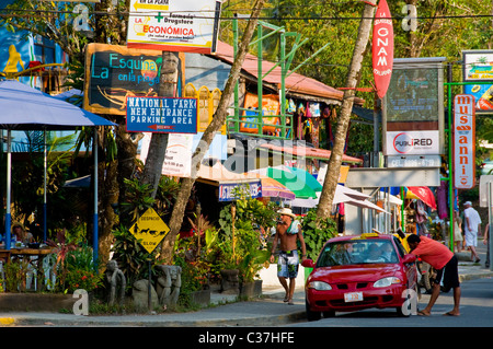 Street scene Manuel Antonio Town at the entrance of Manuel Antonio National Park Puntarenas province Costa Rica - Stock Photo