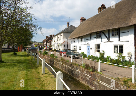 Row of old thatch roof Cottages at East Meon in the Meon Valley, Hampshire, UK - Stock Photo