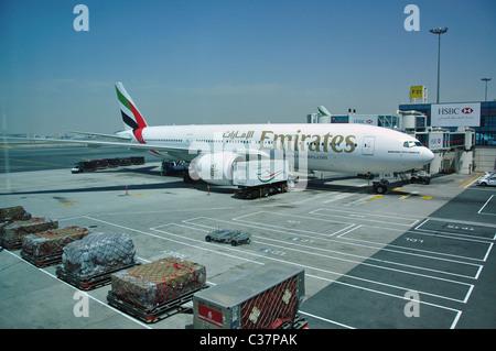 Emirates aircraft at gate, Dubai International Airport, Al Garhoud, Dubai, United Arab Emirates - Stock Photo