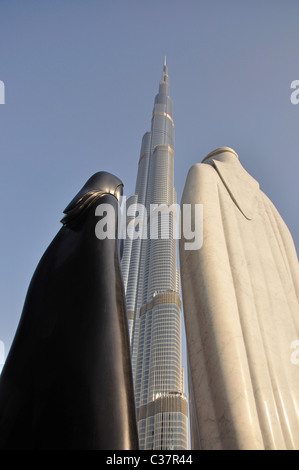 'World's tallest' Burj Khalifa Building and Arab 'Together' sculpture, Downtown Dubai, Dubai, United Arab Emirates - Stock Photo