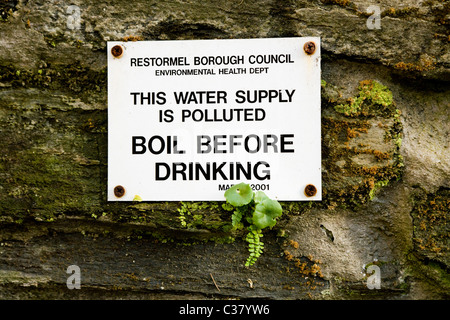 Warning sign by underground natural Cornish spa / spring / mineral water ground source in Lostwithiel, Cornwall. - Stock Photo