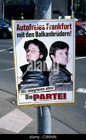 Humorous election campaign poster in Frankfurt am Main pleading for a 'Frankfurt free of cars with the Balkan Brothers'. - Stock Photo