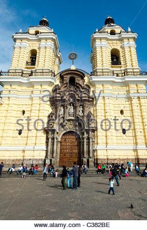 Tourists visiting Saint Francis Monastery (Basilica y Convento de San Francisco de Lima) in Lima, Peru - Stock Photo