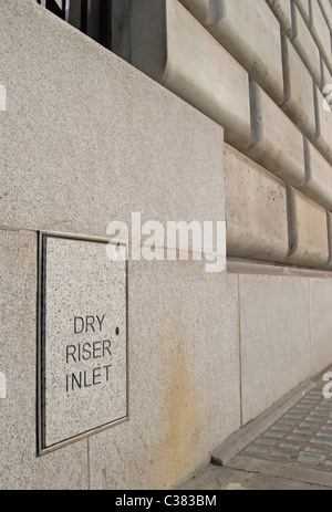 dry riser inlet sign on the front of  unilever house victoria embankment, london, england - Stock Photo