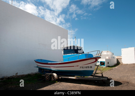Fishing boat on trailer out of the water being repaired El Cotillo Fuerteventura Canary Islands - Stock Photo