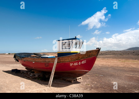 wooden fishing boat out of the water being repaired El Cotillo Fuerteventura Canary Islands - Stock Photo