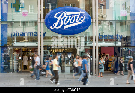 Exterior of a busy Boots store in Central London. - Stock Photo
