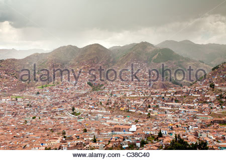 Afternoon rainstorms over Cusco, Peru during the winter rainy season. - Stock Photo