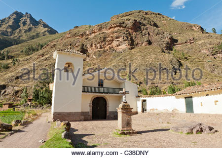 A small white church on the outside of Pisac where masses are given daily in the local Quechua language. Pisac, - Stock Photo