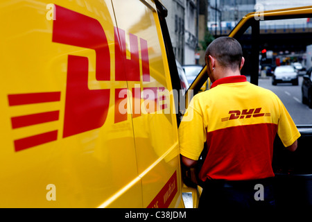 a dhl van driver prepares to make a delivery stock photo 36454806 alamy. Black Bedroom Furniture Sets. Home Design Ideas