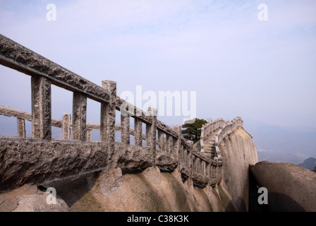 Narrow trail on granite mountain ridge in Mt. Tianzhu National Park in Anhui Province, China - Stock Photo