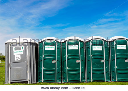 Dilwyn village show, Herefordshire, UK. Line of portable toilets including disabled at fete. Portaloos rented from - Stock Photo