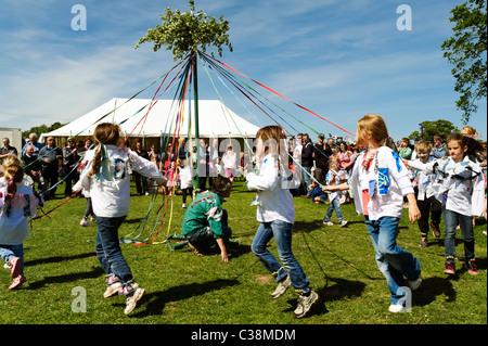 Dilwyn village show, Herefordshire, UK. Maypole dancing in England. Schoolgirls dance around the maypole at spring - Stock Photo