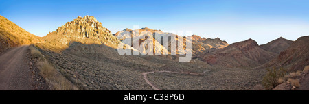 Dirt Road Trail Through Desert Mountains, California, USA - Stock Photo