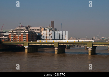 Train crossing Cannon Street Railway Bridge, London, UK - Stock Photo