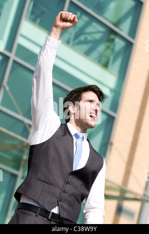 Man with arms in the air - Stock Photo