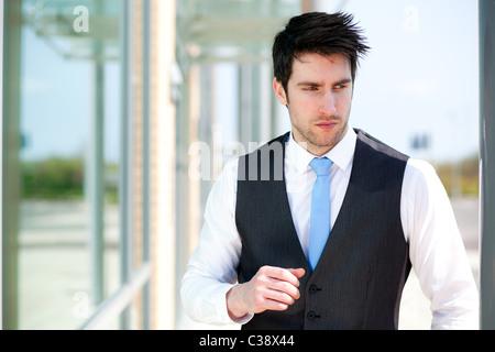 Man stood outside office - Stock Photo