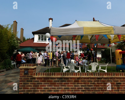 Royal Wedding Street Party in Front Garden of Detached House - Stock Photo