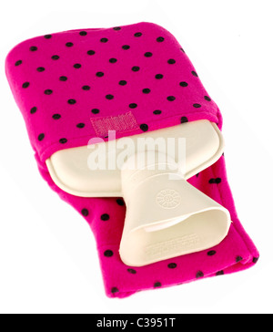 Small rubber hot waterbottle encased in a pink with black spots soft nylon cover - Stock Photo