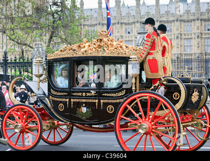 Mr and Mrs Middleton with Camilla riding in carriage after Royal Wedding of Prince William and Kate in 2011. London - Stock Photo