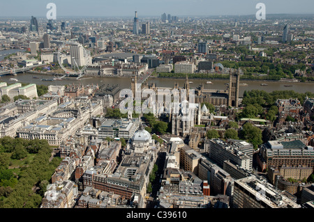 Westminster Abbey, The Houses of Parliament and the City of London from the air. - Stock Photo