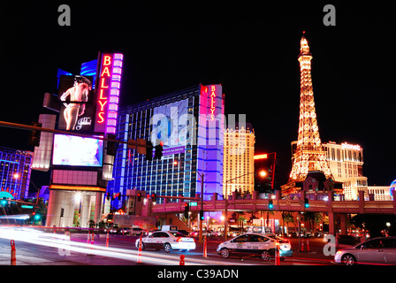 Strip street night scene, Las Vegas, with commercials and luxury hotels - Stock Photo