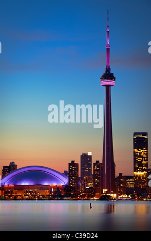 Downtown Toronto skyline, including CN Tower and Rogers Center, as seen in the early evening - Stock Photo
