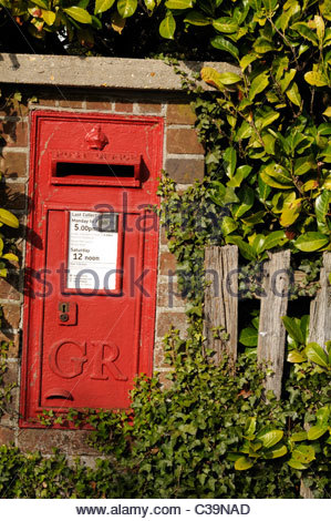 Old fashioned GR postbox, Wimborne, Dorset, England - Stock Photo