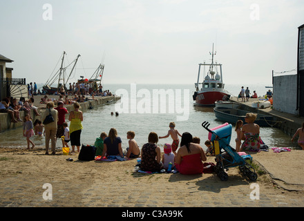 holidaymakers on sand in harbour at Old Leigh, Essex - Stock Photo