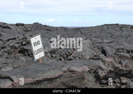 Road closed sign in the middle of lava field on Big Island, Hawaii, - Stock Photo