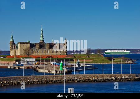 Wallenius Wilhelmsen car carrier is passing through Oeresund at Kronborg in Elsinore Denmark northbound - Stock Photo