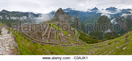 Panorama of empty Machu Picchu complex early on a foggy morning. Machu Picchu, Peru. - Stock Photo