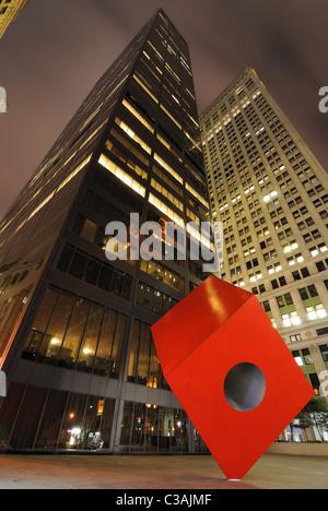 HSBC Building (aka Marine Midland Building) in New York City at night with Isamu Noguchi's Cube. - Stock Photo