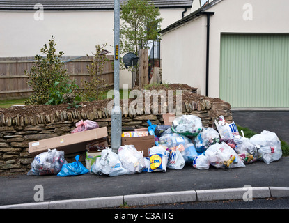 Recyclable household waste put out for kerbside collection. Householders sort the waste into eg glass, plastic, - Stock Photo