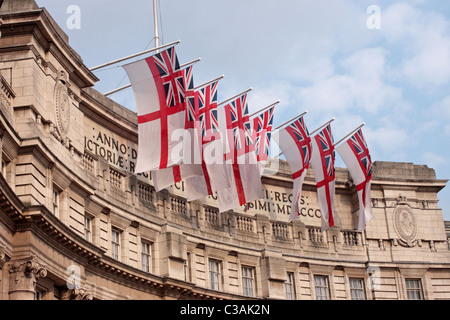 White Ensign flags flying on the Mall side of Admiralty Arch London UK on the eve of the Royal Wedding - Stock Photo