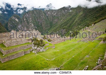 View of the Plaza Principal (main plaza) at Machu Picchu complex seen from Intihuatana. Machu Picchu, Peru. - Stock Photo