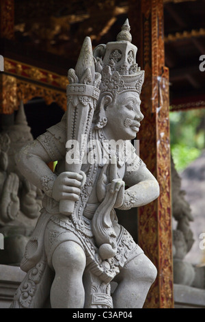 A stone carving of a guardian at PURA TIRTA EMPUL a Hindu Temple complex and cold springs - TAMPAKSIRING, BALI, - Stock Photo