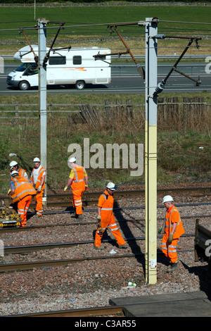 Hi-Visibility Babcock Rail Engineers repairing Train lines at Beattock Summit  Network Rail Contractors in Scotland, - Stock Photo