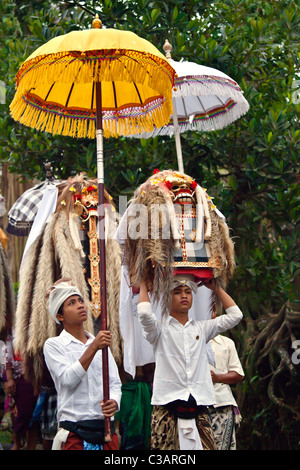 LION MASKS used in traditional LEGONG dancing are carried during a HINDU PROCESSION for a temple anniversary - UBUD, - Stock Photo