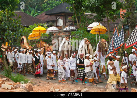 BARONG COSTUME and LION MASKS used in traditional LEGONG dancing during a HINDU PROCESSION for a temple anniversary - Stock Photo