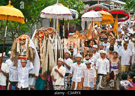 A BARONG COSTUME and LION MASKS used in LEGONG dancing during a HINDU PROCESSION for a temple anniversary - UBUD, - Stock Photo