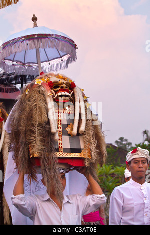 A LION MASK used in traditional LEGONG dancing are carried during a HINDU PROCESSION for a temple anniversary - - Stock Photo