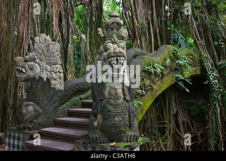 The DRAGON BRIDGE in the MONKEY FOREST PARK - UBUD, BALI, INDONESIA - Stock Photo