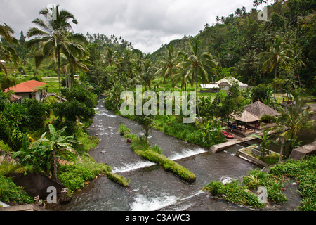 A river used by rafters flows down the flank of GUNUNG AGUNG, the highest mountain on the island - BALI INDONESIA - Stock Photo