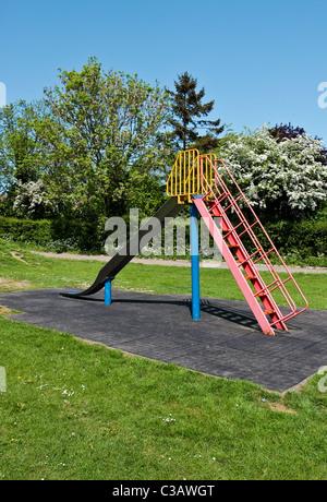 Slide in a playground in Doddinghurst, Essex - Stock Photo
